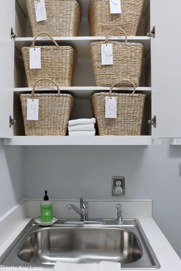 Baskets used for storage on shelves - Laundry Room Organizing Ideas.