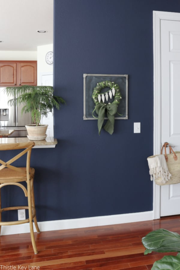 Navy wall with spring wreath decoration. Spring Burlap And Carrot Wreath.