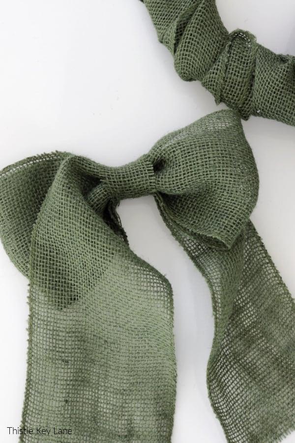 Green burlap bow.