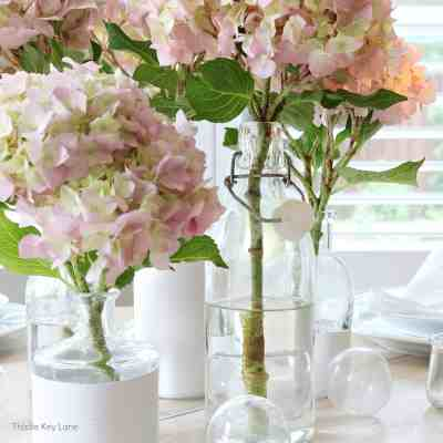 Summer Tablescape With Glass Bottle Vases