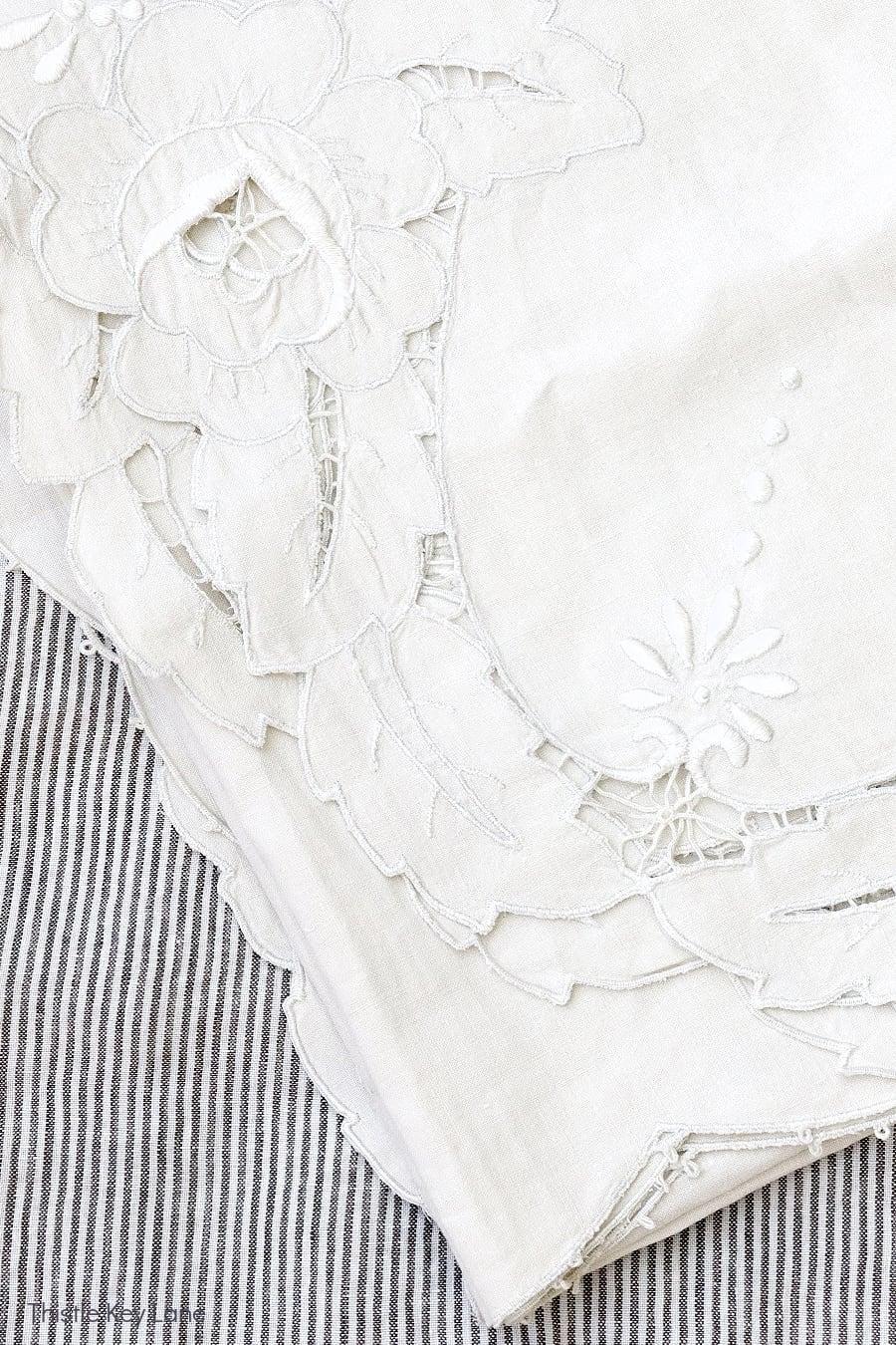 Vintage cutwork linen tablecloth.