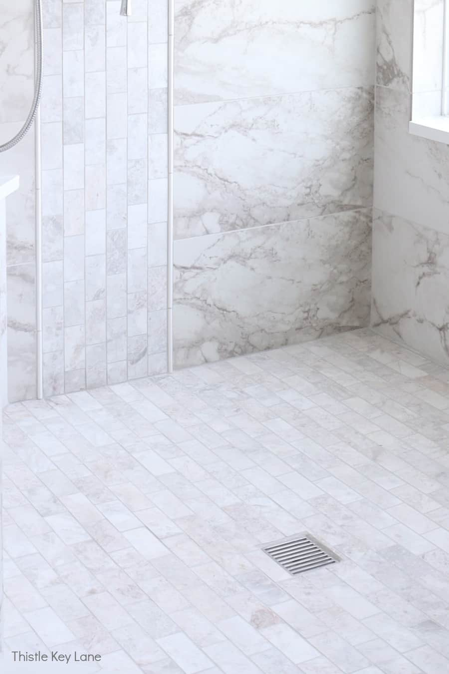 Mosaic marble tile in shower.