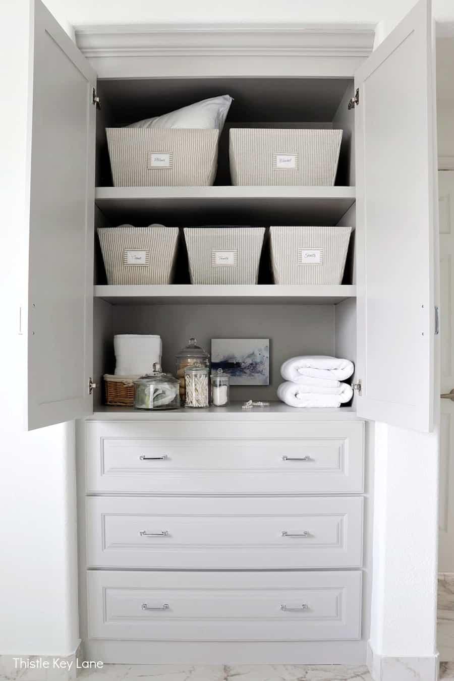 Storage shelves and drawers for bathroom. Organizing A Master Bathroom Linen Closet.