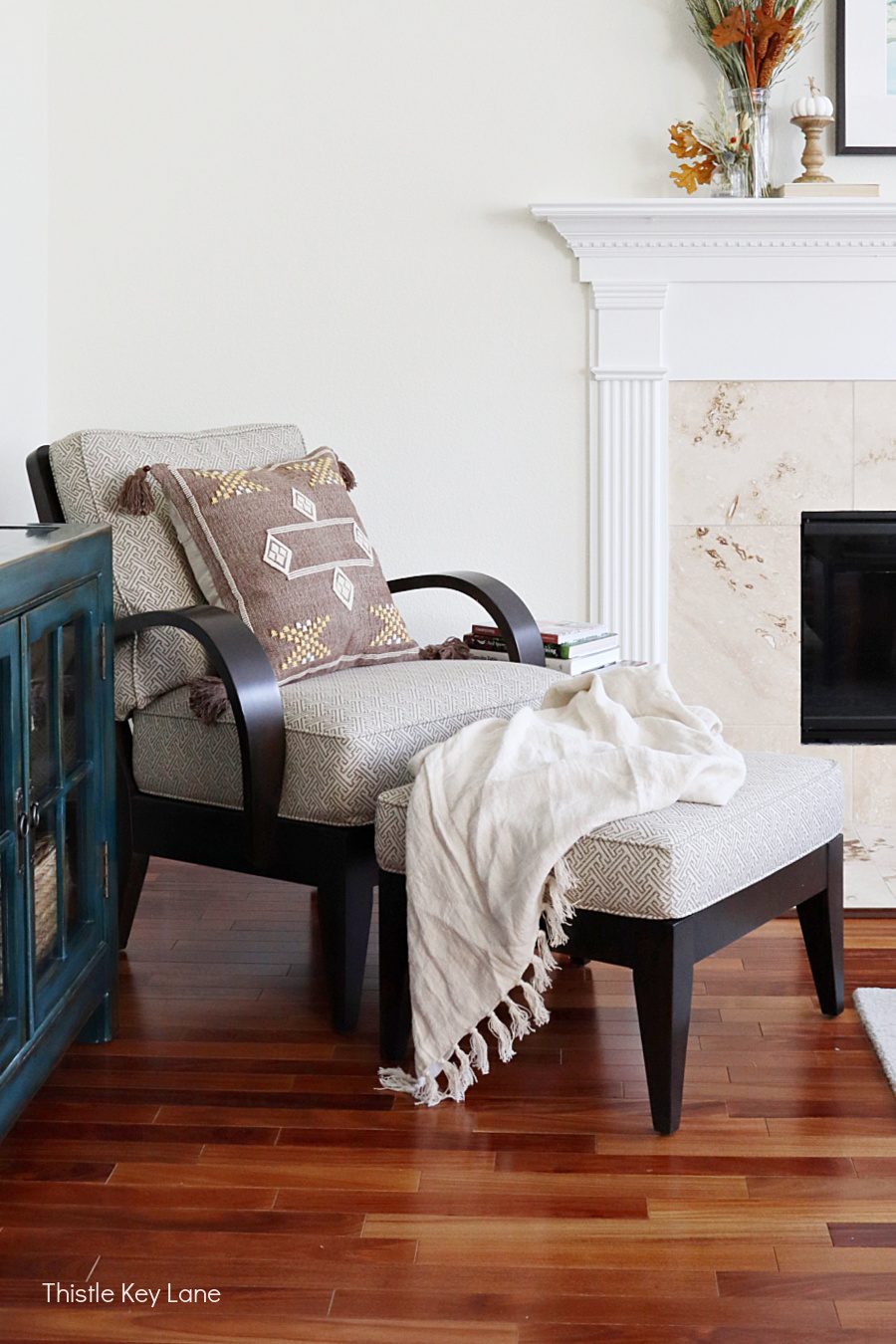 Arm chair and ottoman with pillow and throw. Fall Home Tour With Neutral Colors.