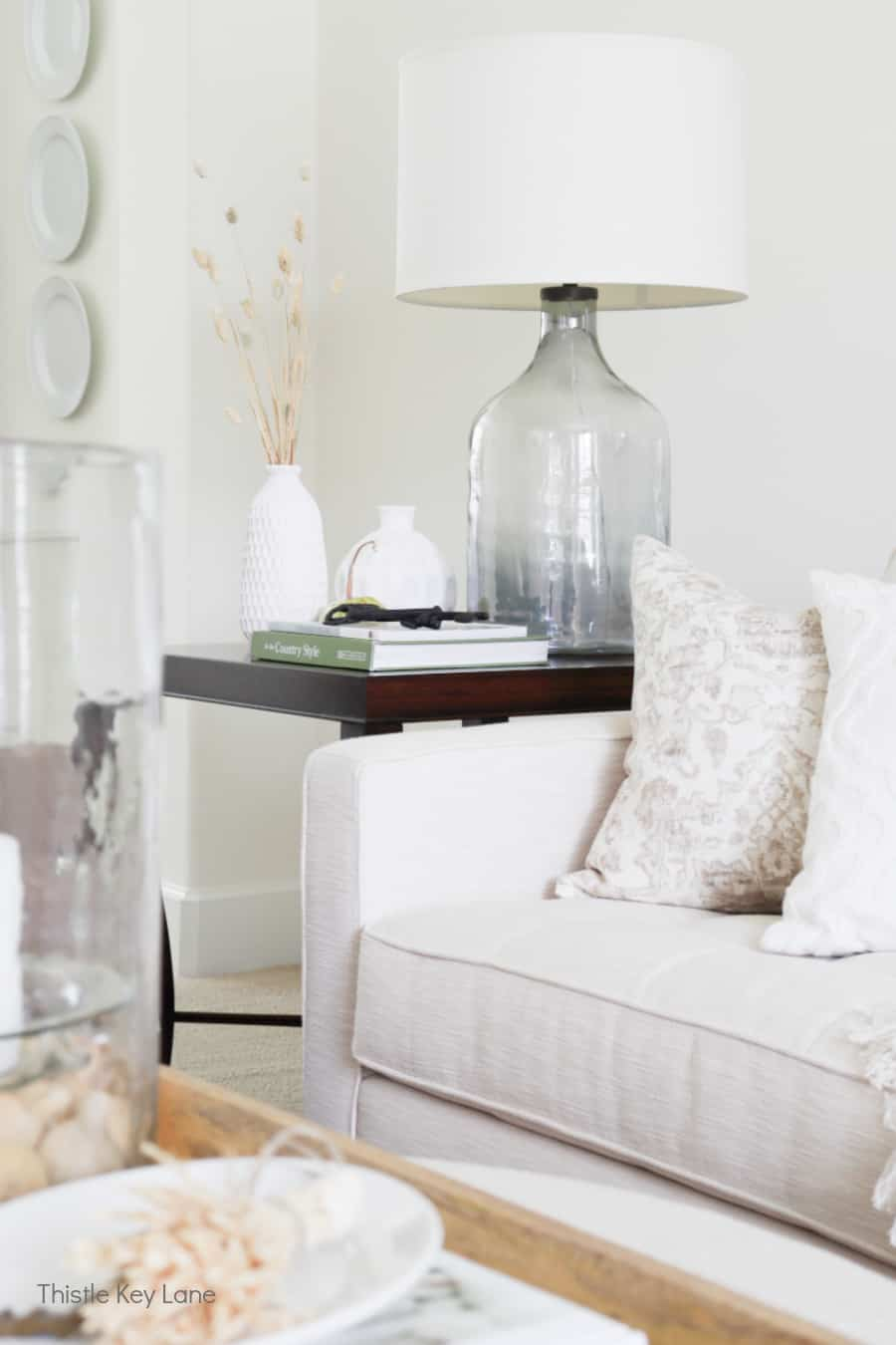 Sofa and end table with neutral colors. Subtle Ways To Decorate For Fall.