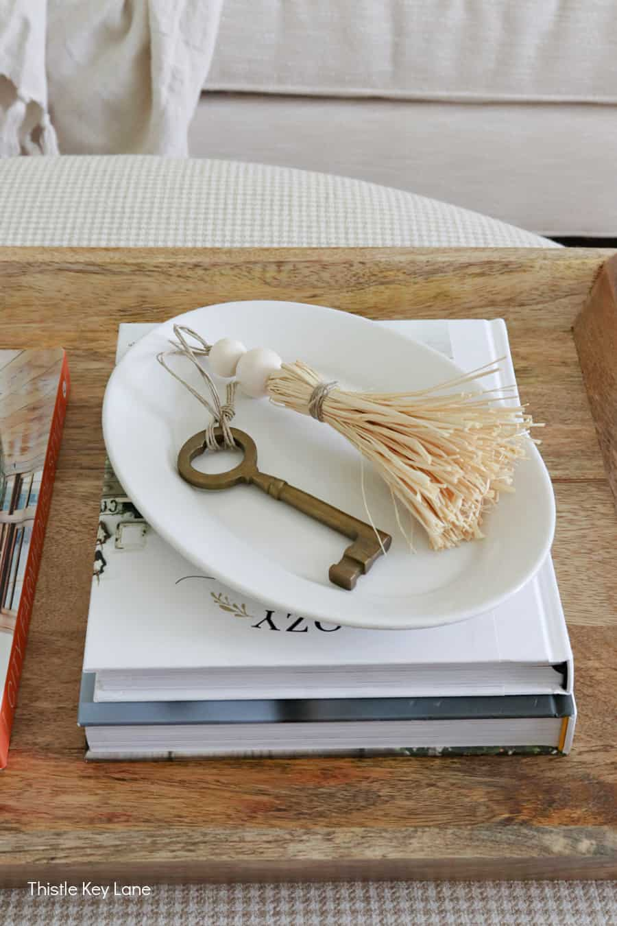 Ironstone plate with key and raffia tassel. Subtle Ways To Decorate For Fall.
