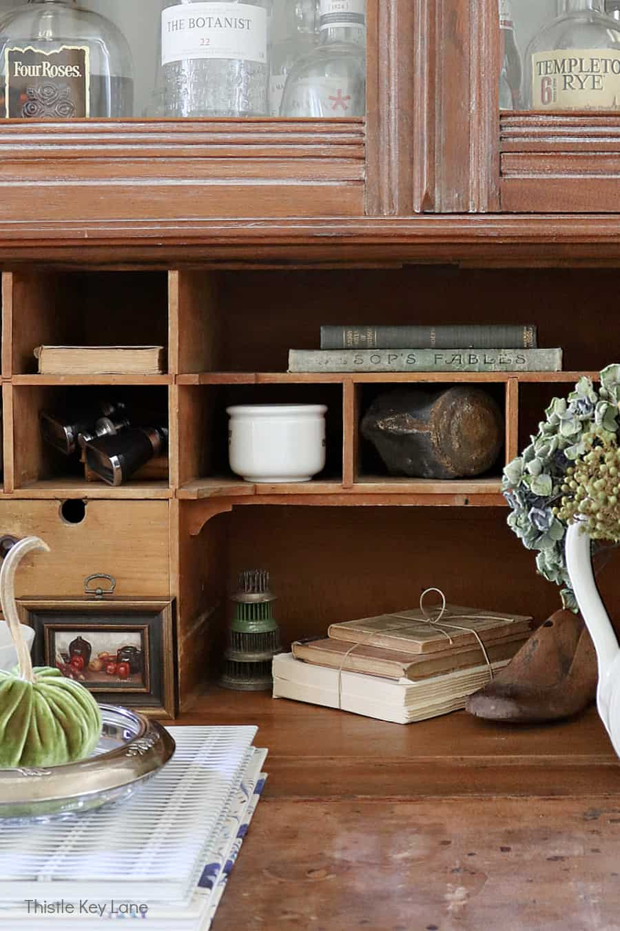 Secretary desk storage nooks with vintage collections.