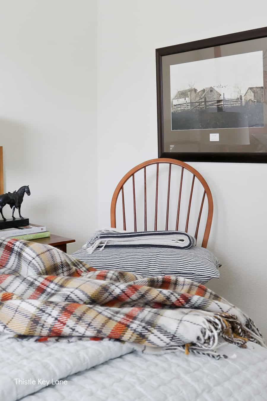 Windsor chair with ticking pillow and throw.