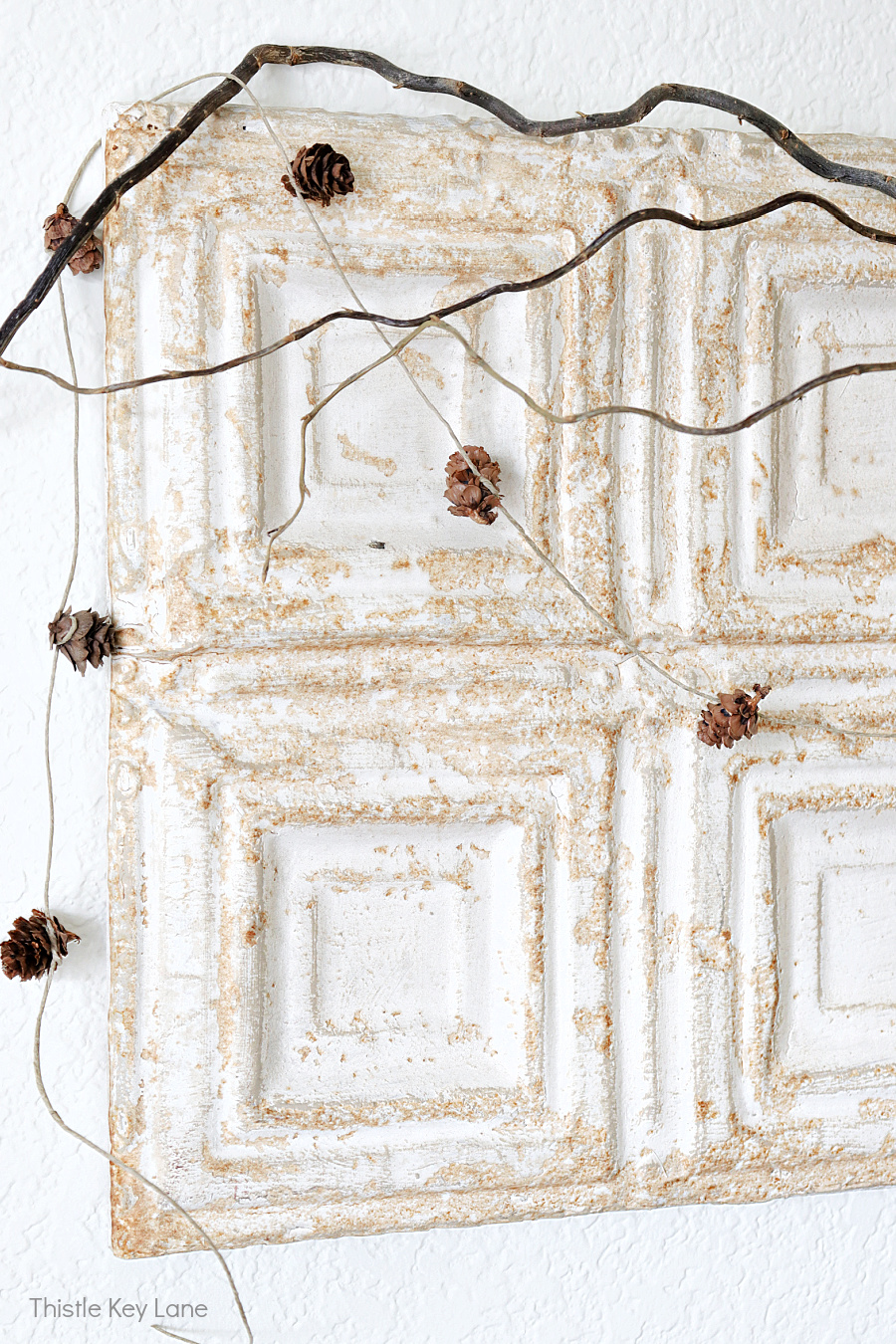 Rustic ceiling tile with a garland.