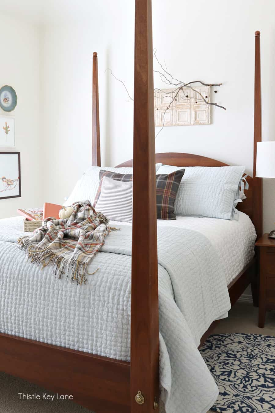 Shaker style bed, light blue bedding, plaid accents. Simple Fall Bedroom Ideas.