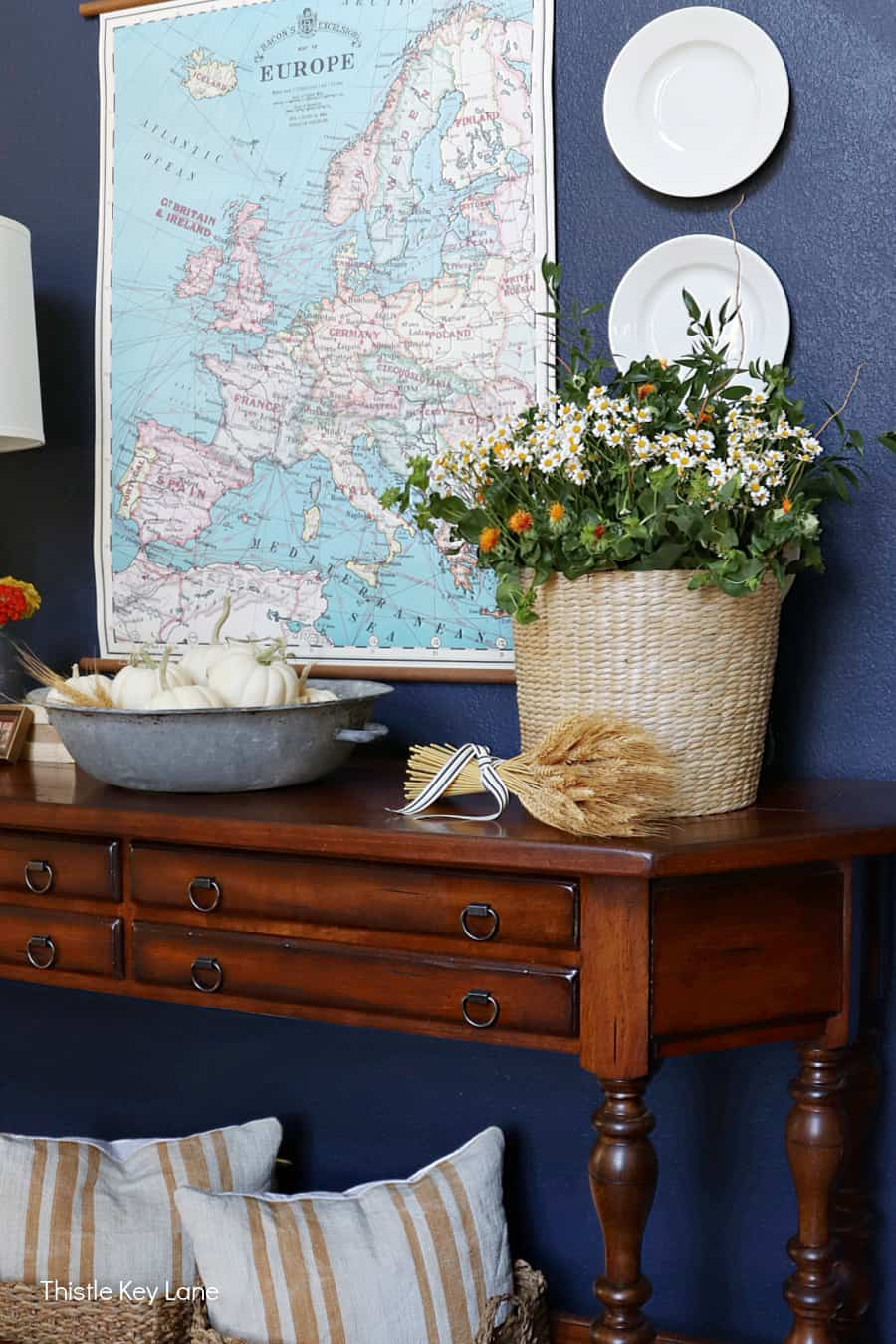 Entry table with fall flowers.