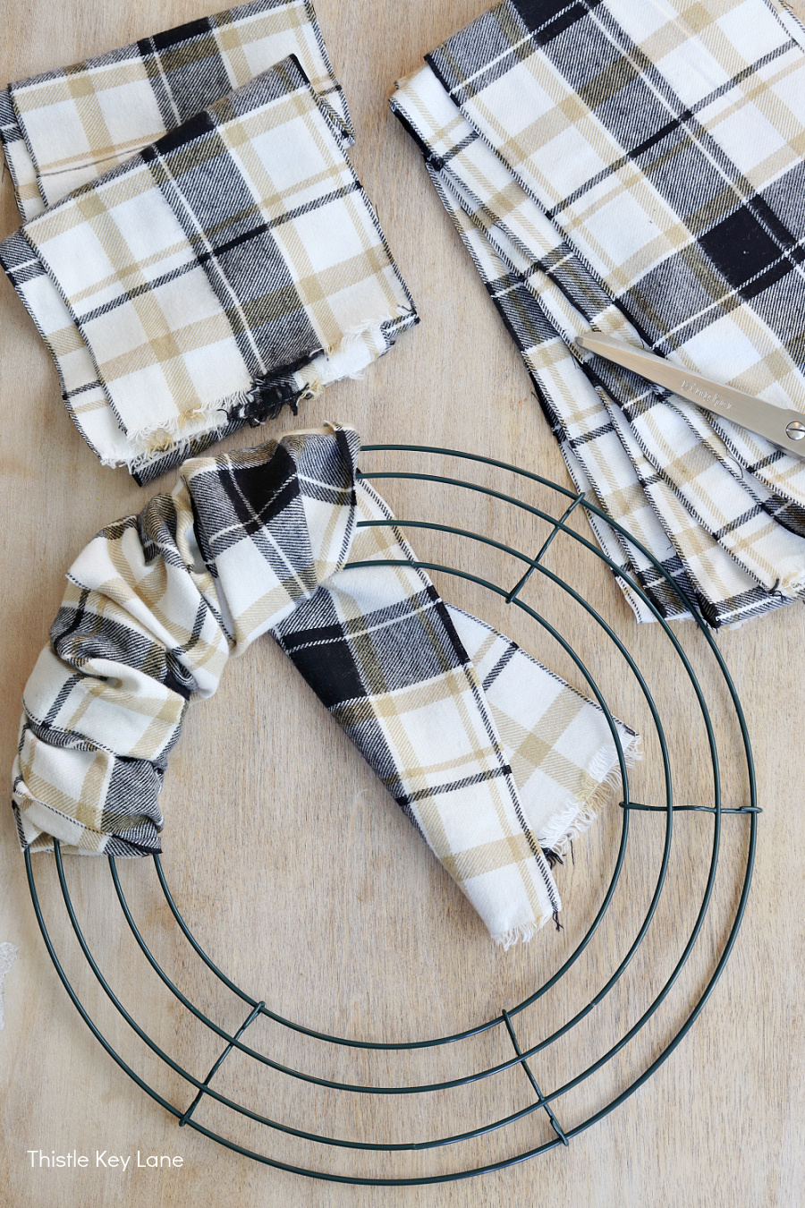 Plaid fabric and wire wreath form.