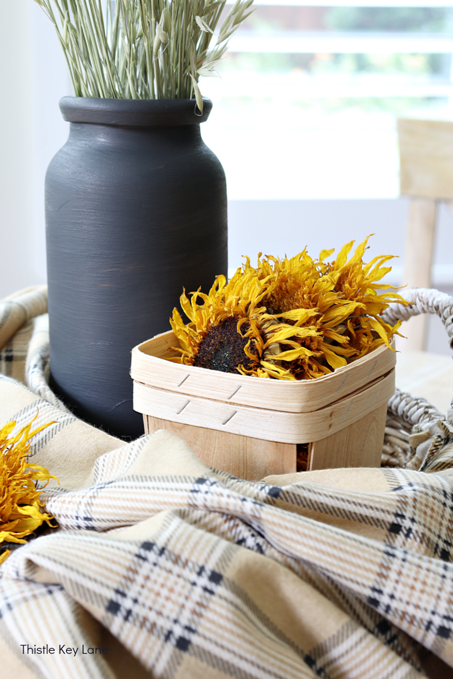 Dried sunflowers in a basket. How To Make A Plaid Table Throw.