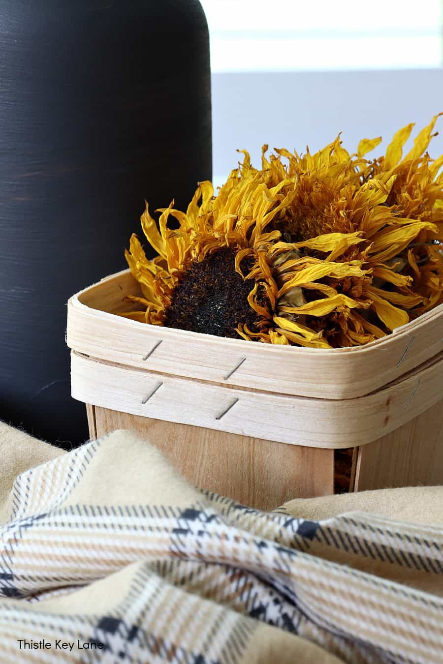 Berry basket with dried sunflower heads. How To Make A Plaid Table Throw.