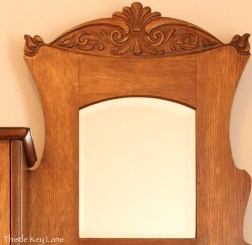Carving above the mirror