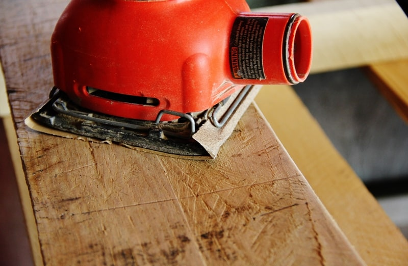 Sand the wood on your assembled pallet desk before staining.