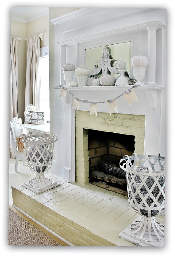 The variety of white painted pumpkins on the fireplace mantel are perfect for autumn.