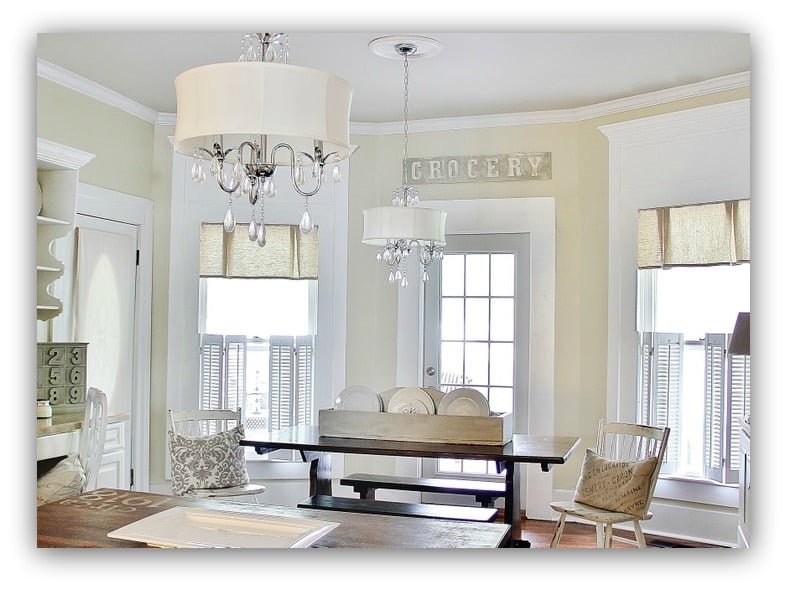 This elegant farmhouse living room is classic with neutral tones and lots of light.