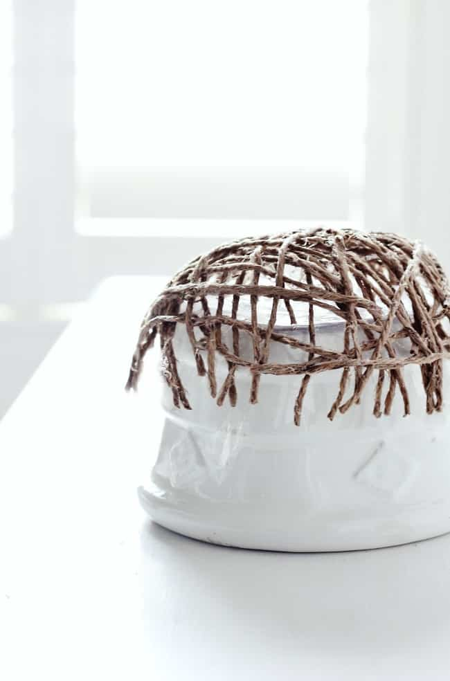 Drape the twine over the bowl