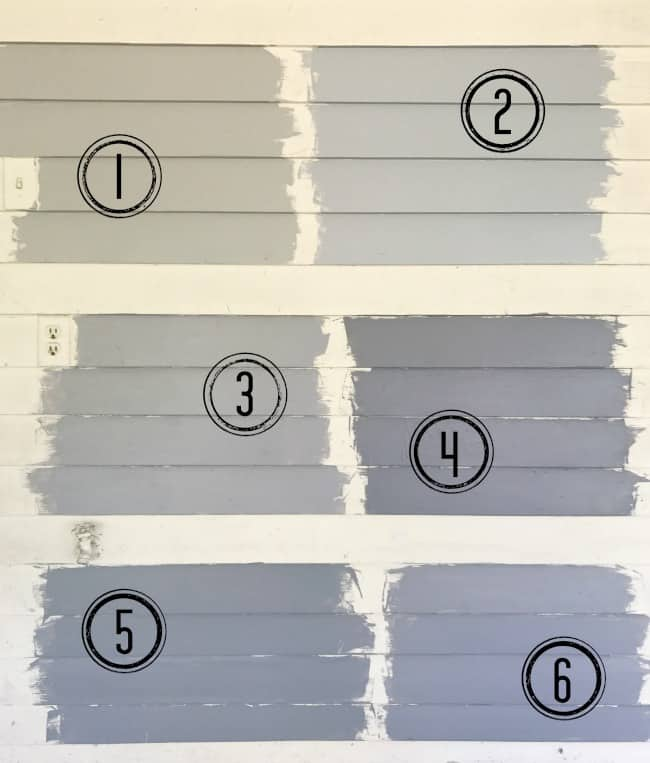 Six exterior grey paint colors sampled on the wooden exterior of my home