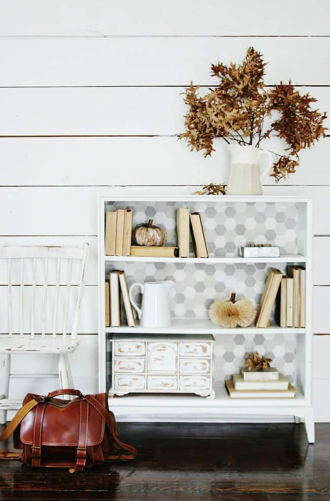 Adding tile to the back of an old bookcase easily changes the look and feel of your furniture.