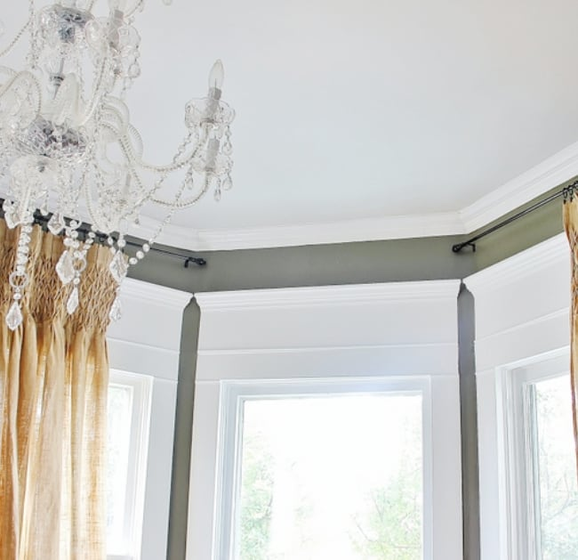 add molding over your windows with this simple home decor hack