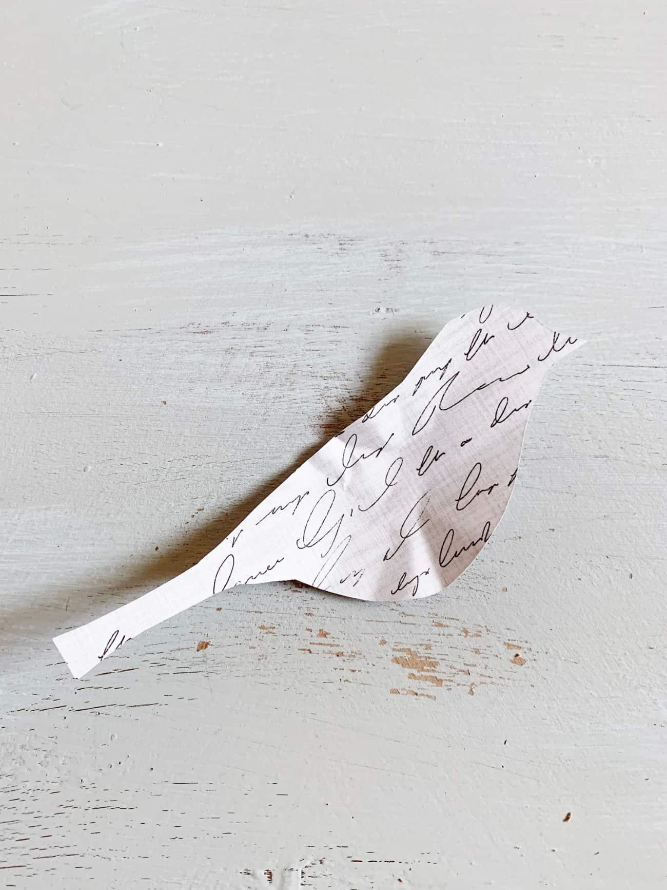 book page wreath bird