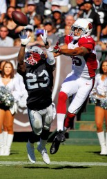 Arizona Cardinals wide receiver Michael Floyd (15) beats Oakland Raiders cornerback Tarell Brown (23) for a touchdown during an NFL football game against the Oakland Raiders on Sunday, October 19, 2014 in Oakland, CALIF. Arizona won the game 24 to 13. (AP Photo/Peter Read Miller)