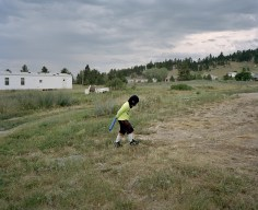 "Marcus Gone playing ""Army"" and killing bad guys in the backyard of his Mothers House near Hays at the south end of the Fort Belknap Indian Reservation, Montana."