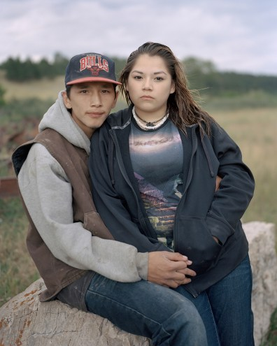 """Jasper Lewis and his girlfriend Aliyah Eagle Man near a pond where they went swimming on the Fort Belknap Indian Reservation, Montana. Jasper is 18 years old and works with horses, though he wants to be a mechanic. He recently broke his first horse, a half Indian Pony called """"Blue Lodgepole"""". His girlfriend Aliyah is from Rockyboy Indian Reservation, which is around 80 miles from Fort Belknap."""