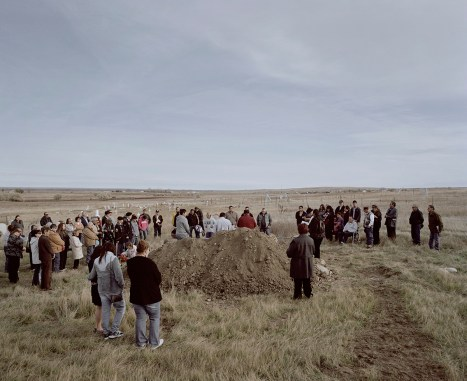 A funeral on a near hill next to the Fort Belknap Agency. There is a funeral almost every week. Life expectancy on Reservations is often below the national average. Domestic violence, drug abuse and especially alcohol abuse are common. Numbers are equal to developing countries. During the funeral people play the hand drum and sing the ones (who-is-gone) song to help the spirit to get back to the sky people.