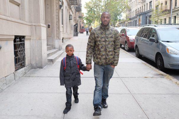 Bronx, NY Oct. 12, 2014 Every morning Travis walks his son 10 blocks to his school. Photo by M.B. Elian
