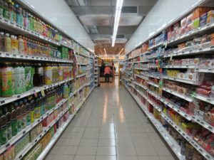 grocery store aisle with fully stocked shelves