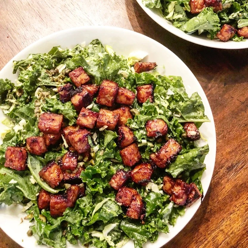 Vegan Caesar Salad with BBQ Tempeh | A twist on the classic Caesar, this salad is not meant to sit on the side of some other dish. You'll want to make this one the main event. | thiswifecooks.com