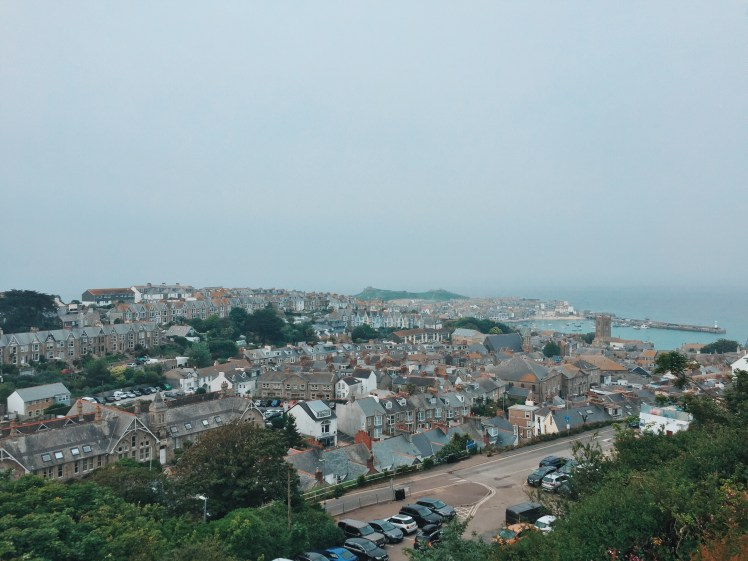 As close as a birds eye view as possibly human, showing the town of St. Ives below from the main car park that is situated top of the hill. The harbour and coastal front are visible from this height, even with overcast weather.
