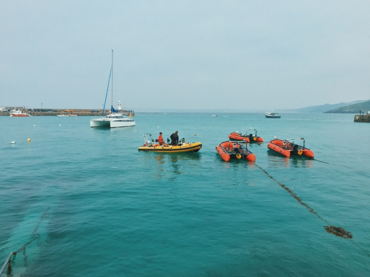 Lifeboats floating atop the water in St. Ives Harbour