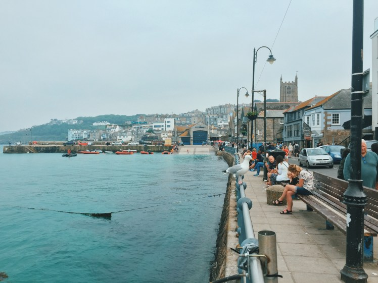 The edge of the town until the waters edge. The best spot in town to see everything happening