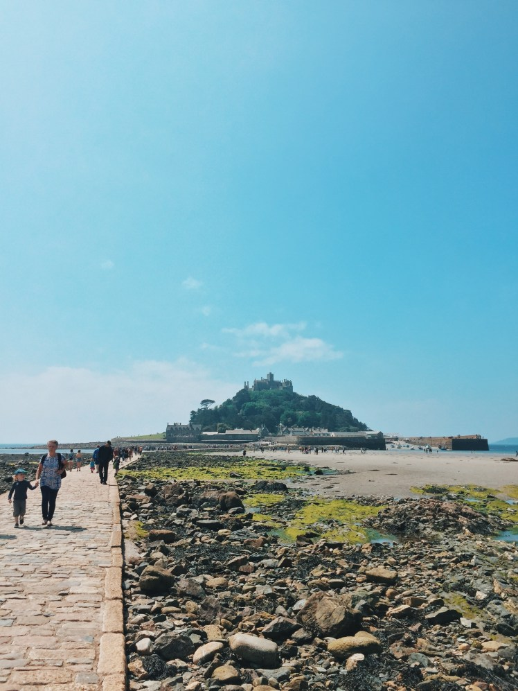 Low-tide with a clear causeway leading up to St. Michael's Mount in the distance.