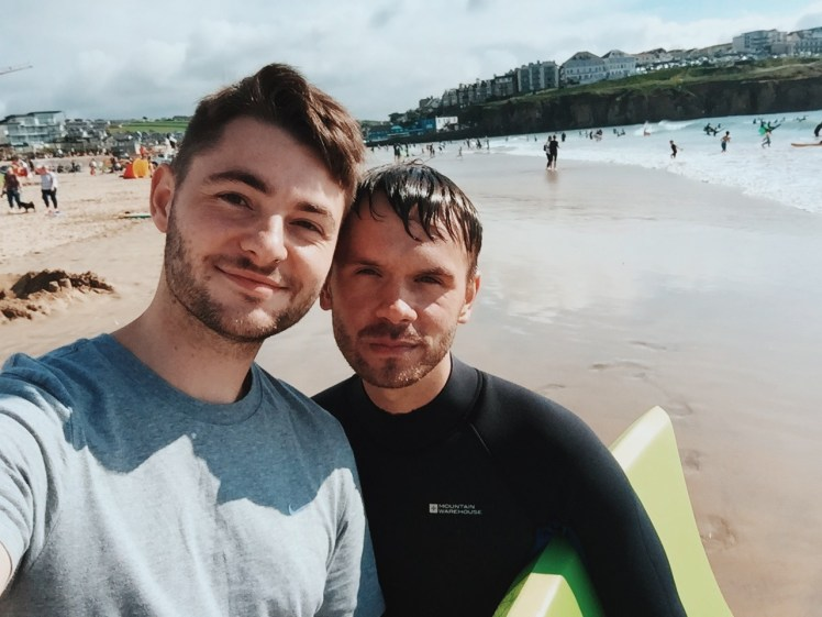 A simple short of Tommy (me) and my handsome boyfriend Jacob with the town of Perranporth behind us. We were standing near the waters edge with everyone around us enjoying the beach.