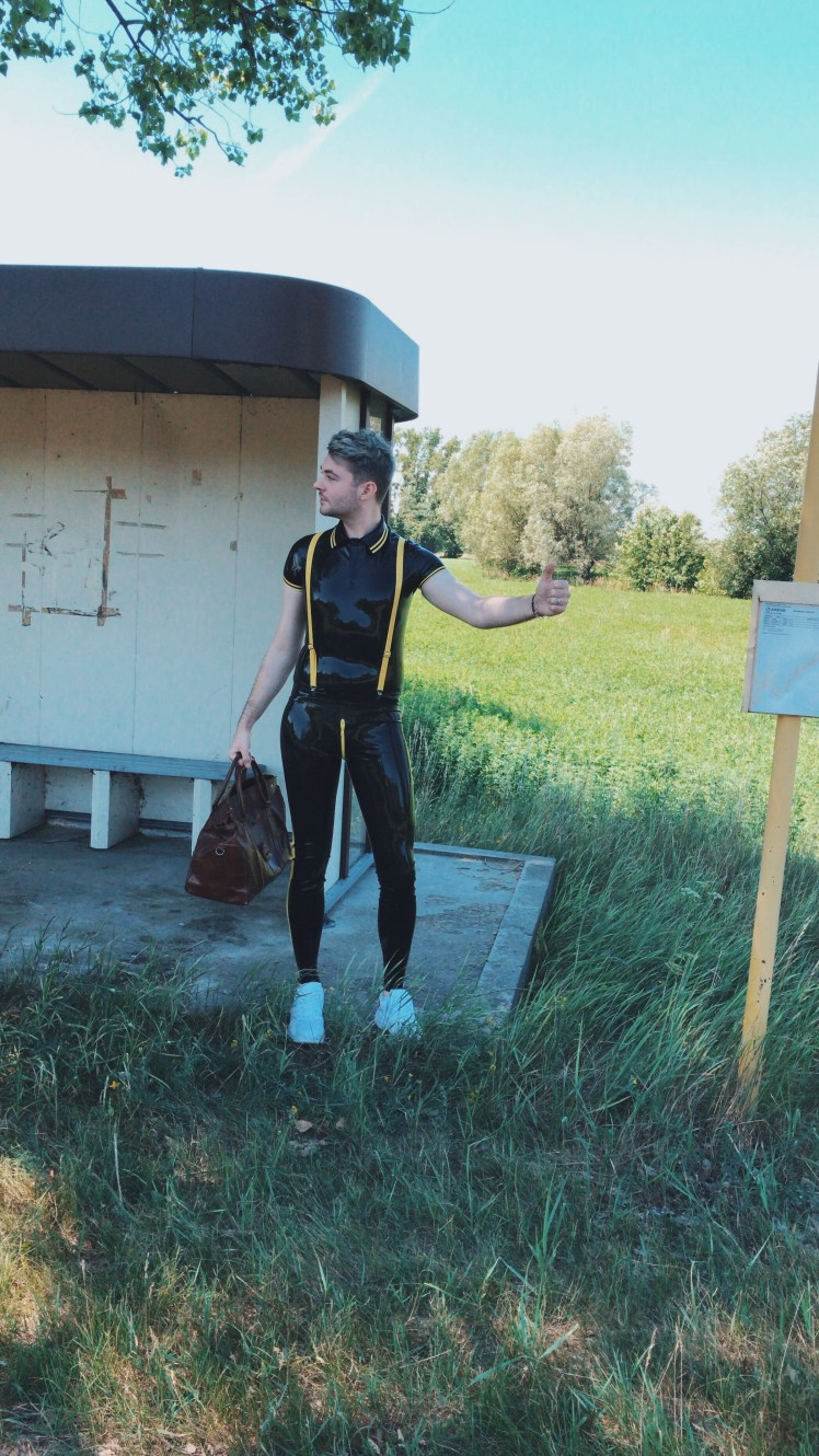 A full outfit shoot in Poland at the bus stop. Featuring the latex/rubber skinhead set by the gay fetish brand Regulation London. The set contains a polo shirt, skinny jeans and braces.
