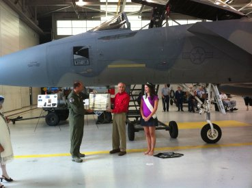 Mayor Kovash and one of the Princesses unveil the nose art.