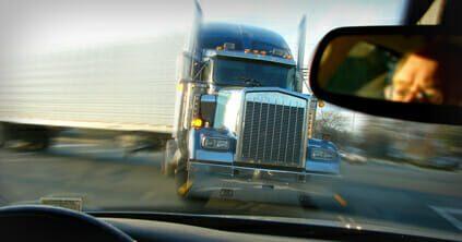 18-wheeler truck driving toward driver in car
