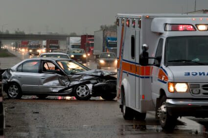 Damaged car from an accident with responding ambulance
