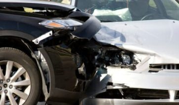 A black car and white car damaged in a crash