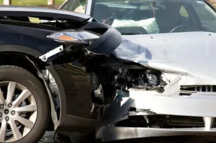A black car and white car damaged in a crash