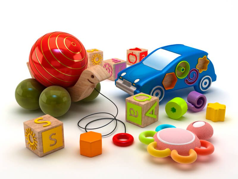Group of child and infant toys including blocks, rattle, and pull toy
