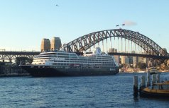 A big boat and the Harbour Bridge.