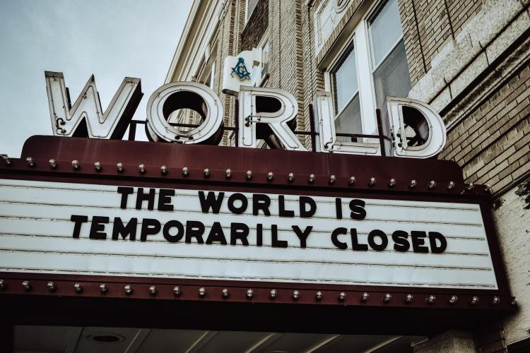 Sign outside cinema that says 'the world is temporarily closed' due to coronavirus