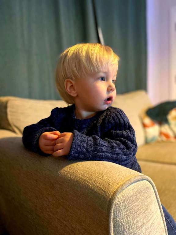 Boy called Noah watching TV on the settee