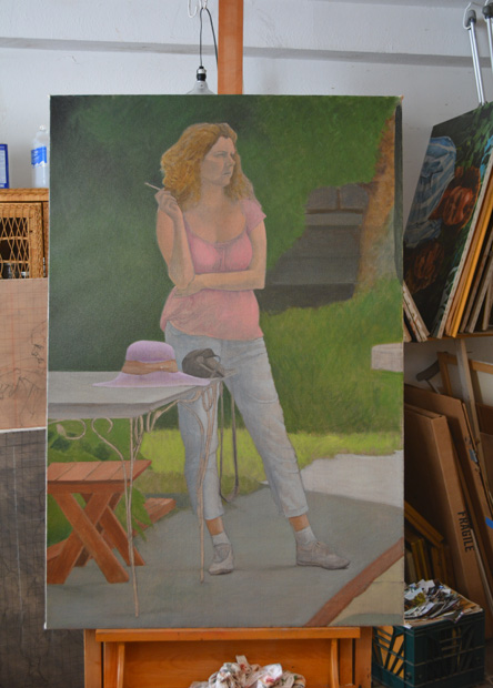 The unfinished painting titled 'The Photographer' on the easel